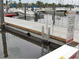 3 step FloatStep® Dock Ladder on a concrete floating dock