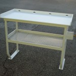 4 legged fish cleaning table with hose holder and shelf
