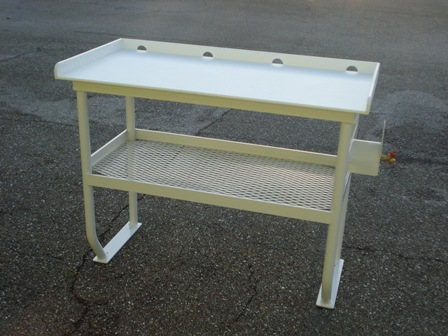 AA&MP donates a 4 legged fish cleaning table with hose holder and shelf