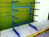 This is a 5 board paddle board rack with TIG welded construction, blue powder-coating and cork padding on the rack arms.