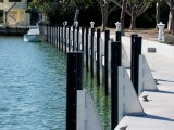 These aluminum fender brackets with Defend-HER dock fenders were installed on a new concrete seawall in Islamorada, Florida.