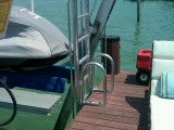Shown here is a lift or retractable ladder on a residential dock in Miami, FL.