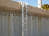 Custom Beach Access Ladder that allows the homeowners to enjoy the beach and ocean.