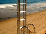 Aluminum Seawall Lift Ladder pulls up and locks to prevent damage from storms.