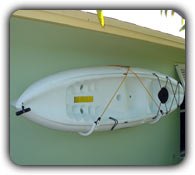 single kayak shack rack mounted on a wall