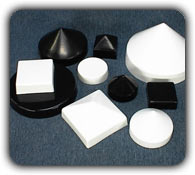 various sizes of white and black dock piling caps