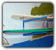 double sup board rack mounted on a wall