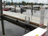 FloatStep dock ladders mounted on a concrete floating dock.