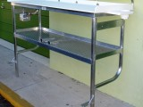 two legged fish cleaning table with upper shelf